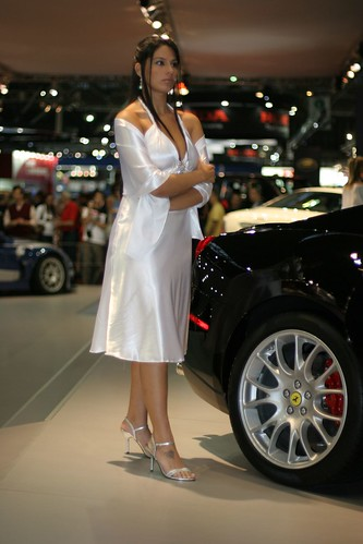 Strong Lady in white dress and Ferrari 599 GTB
