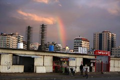 A rainbow shines in the sky above the city following a rainstorm over Gaza (TeamPalestina) Tags: freepalestine palestinian sunrise sweet beautiful heritage live photo photographer comfort natural تصويري palestine nice am amazing innocent occupation landscape landscapes reflection blockade hope canon nikon
