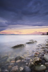 Stormclouds at Lake Constance (johaennesy) Tags: bodensee lakeconstance clouds longexposure langzeitbelichtung opensourcesoftware gimp rawtherapee stones waves water evening friedrichshafen badenwürttemberg germany vertical sunset