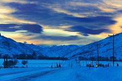 Yellowstone Highway In Winter (wyojones) Tags: wyoming wapitivalley cody winter snow yellowstonehighway absarokamountains road sunset evening twilight reflection wyojones np