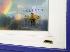This Time It's Bold (Coastal Elite) Tags: halifax logo branding this time its bold window rainy rain theodore tugboat transformer boat rainbow flag northend decal fenêtre novascotia droplets