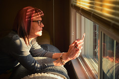 iPhonetography (flashfix) Tags: march242018 2018inphotos ottawa ontario canada nikond7100 40mm nikon flashfix flashfixphotography portrait woman pinkhair window couch blankets iphone reflection settingsun warmlight