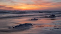 Stones in the light of the rising sun (venolab) Tags: dawn stones waves ocean sunrise firstlight orangesky seaside beach seascape landscape landschaft inselusedom bansin usedom