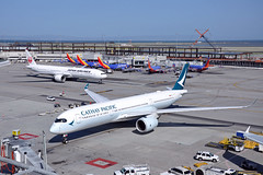 SFO In n Out (Rich Snyder--Jetarazzi Photography) Tags: japanairlines japanair jal jl boeing 777 777300er 777346er b777 b77w ja739j cathaypacificairways cathaypacific cathay cpa cx airbus a350 a350900 a350941 a359 blra arriving arrival departure departing sanfranciscointernationalairport sfo ksfo millbrae california ca airplane airliner aircraft jet plane jetliner ramptowera rcta atower