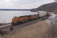 Q25303 in Stony Point - 3/03/2018 (John McCloskey Jr.) Tags: transportation orange grass trees scenic water railroad trains outdoors newyork hudsonriver sd75m gevo atsf bnsf csx