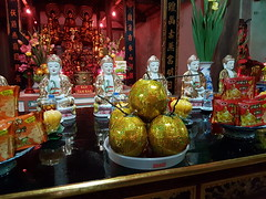 Buddhist Temple (Terry Hassan) Tags: vietnam quếvõ buddist temple altar offering statue sculpture religious indoor interior buddhist buddha