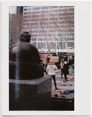 Michael Nesmith Commemorative Bobble Hat Statue in Bryant Park (yarr2d2) Tags: speedgraphic graflex notreally4x5 largeformat fujiinstaxwide polaroid fujiroid doxie nyc newyorkcity gertrudesteinstatue bryantpark notabobblecap juggling