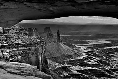 Looking Through a Portal of Mesa Arch to Views of Canyonlands National Park (Black & White, Canyonlands National Park) (thor_mark ) Tags: airporttower anseladamslookfromcapturenx2 azimuth90 blackwhite buckcanyon canvas canyon canyonwalls canyonlands canyonlandsnationalpark canyons capturenx2edited centralcanyonlands colorefexpro coloradoplateau day5 desertlandscape desertmountainlandscape highdesert intermountainwest islandinthesky islandintheskydistrict lasalmountains landscape layersofrock lookingeast mesaarch mesaarcharea middlefork monstertower mostlycloudy nature nikond800e outside overcast portallikeview portalview portfolio project365 sandcastletower sandstonetower sandstonetowers utahhighdesert utahnationalparks2017 walktomesaarch washerwoman washerwomanarch washerwomanarchmonstertower ut unitedstates
