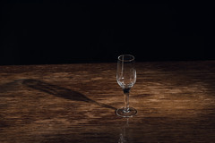 Alone Glass on the Table (donnicky) Tags: alone blackbackground closeup dishes glass indoors light madeofwood nopeople old oldfashioned publicsec retro shadow singleobject stilllife studioshot table vintage