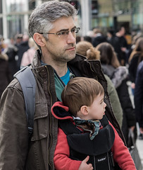 Keeping him close to my chest (Nikonsnapper) Tags: olympus omd em1 zuiko 75mm man child baby carrier chest looking street candid cardiff colour