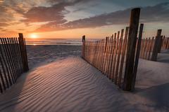 A Monday sunrise 2 (tgurgul) Tags: beach water blue orange ocean sand waves light sky landscape fence
