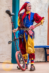 Elijah (Unicycle) (Paulann_Egelhoff) Tags: paulann paulannegelhoff professional photography art design phoenix arizona az renfair renaissance renaissancefestival renaissancefair vaudeville circus family familycircus clan tynker clantynker juggle juggling rings ring bubbles poi unicycle accordion knives mask dance jester outfits period periodpieces colors colorful color vivid bright motion movement blur capture photo headshot action outdoors fun