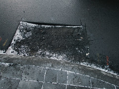 Reykjavik (BurlapZack) Tags: olympustoughtg5 vscofilm pack01 reykjavik iceland is reykjavikiceland street sidewalk curb lostglove aslphalt pothole walkabout travel vacation underconstruction brick asphalt concrete city urban glove winter pointandshoot compact digitalcompact advancedcompact waterproofcamera waterproofcompact toughcompact raw