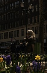 """""""Waiting for the spring to turn into the fall. Love don't mean what it says at all."""" - Stevie Nicks (Lidiya Nela) Tags: urban city people nyc newyork newyorkcity manhattan bryantpark park street streetphotography shadow light mood atmosphere emotion candid woman flowers spring"""