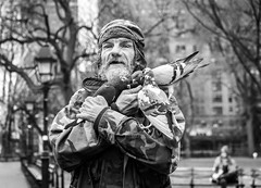 For the Birds (John St John Photography) Tags: washingtonsquarepark greenwichvillage newyorkcity newyork streetphotography candidphotography man birds pigeons feeding birdguy bw blackandwhite blackwhite blackwhitephotos johnstjohn