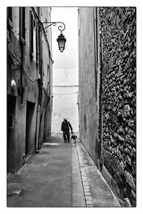 Street (Hugedé Loïc) Tags: man dog street lampadaire stone wall france hat