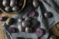 Raw Organic Purple Baby Potatoes (brent.hofacker) Tags: agriculture background color colorful crop delicious diet food fresh harvest health healthy heap natural nature nutrition organic pile plant potato potatoes produce purple purplepotato purplepotatoes raw root starch sweet tasty tuber uncooked vegan vegetable vegetables vegetarian violet yam