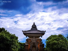 Balinese Temple (Ananya Saha) Tags: canon indonesia bali island beautiful vivid architecture balinese hindu temple white clouds green trees blue sky