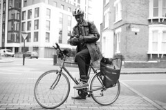 IMG_6420 (JetBlakInk) Tags: afro brixton candid composition men transport cyclist cycle bicycle streetphotography cellphone satnav streetmap delivery