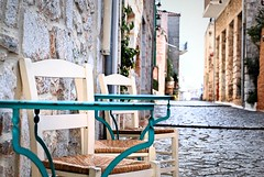 Your morning coffee will be served soon (jimiliop) Tags: cafe chairs tables greece mani areopoli stone paved pedestrian area street alley traditional architecture picturesque cyan oldtown medievaltown