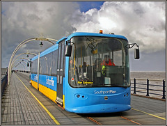 Southport Pier Tram (Jason 87030) Tags: blue yellow southport october windy 2013 weather clouds sky light transport entrance pier northwest uk england seaside canon eos