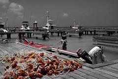Red..... (rienschrier) Tags: boten water haven vissernetten selectievekleur zwartwit blackandwhite