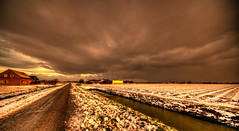 Ominousness. (Alex-de-Haas) Tags: 11mm aurorahdr d750 dutch hdr holland irix nederland nederlands netherlands nikon noordholland photomatix westfrisia westfriesland art artistic artistiek beautiful betoverend bevroren boerenland cloud clouds cold daglicht daylight desolate farmland fire flat frozen heaven hemel kou kunst landscape landschap licht light lucht mooi plat polder skies sky sneeuw snow sunrise verlaten vuur water winter wolk wolken wonderful zonsopgang
