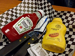 Tray With Condiments. (dccradio) Tags: lumberton nc northcarolina robesoncounty indoors inside arnolds arnoldsrestaurant ketchup heinz tomatoketchup catsup condiments mustard monarch steakknives checkered moisttowelette mayonnaise table eat meal lunch dinner supper samsung galaxy smj727v j7v cellphone cellphonepicture photooftheday photo365 project365 blackandwhite bw