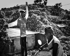 Jinka Traffic Cop (Rod Waddington) Tags: africa african afrique afrika äthiopien ethiopia ethiopian etiopia ethiopie etiopian jinka traffic cop town motorbike man blackandwhite monochrome mono outdoor police houses