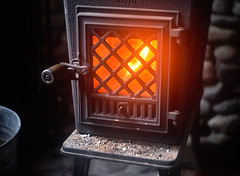 Taking off the Chill (Aerogami.com) Tags: cabin wood stove woodstove alaska log fireplace fire glow warm embers cast iron jotul 602