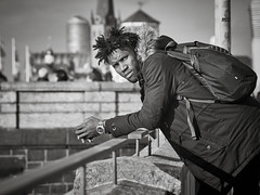 candid.portrait (grizzleur) Tags: olymplus omd omdstreetphotography bw mono monochrome blackandwhite street photography candid olympusomdem5mkii candidphotography candidportrait black guy dude eyecontact eyes laidback relaxed spring leading lines line hair hairdo cool stare gaze scar