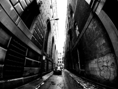 Old Montreal Alley (MassiveKontent) Tags: noiretblanc blackwhite montreal bw contrast city monochrome urban blackandwhite streetphoto montréal building quebec streetphotography bwphotography streetshot gopro fisheye architecture geometric lines symmetry oldmontreal concrete asphalt alley brick