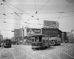"""Trolley Cars on Flatbush and Atlantic Avenue"" Photograph (about 1950), New York Transit Museum, Brooklyn, New York City (jag9889) Tags: 2016 20160612 anniversary architecture atlanticave atlanticavenue auto automobile bw beverage blackandwhite boulevard brooklyn building car cocacola coke downtownbrooklyn drink flatbushavenue house indoor intersection kingscounty mta metropolitantransportationauthority monochrome museum ny nyc nytm newyork newyorkcity newyorktransitmuseum photograph road sign street transit transportation trolley usa unitedstates unitedstatesofamerica vehicle jag9889"