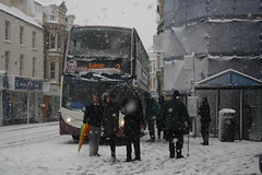 Catching the bus....? (lazy south's travels) Tags: teignmouth south devon england english britain british uk bus stagecoach enviro 400 scania hop2 candid town center centre snow winter extreme weather 15894 passengers wa13gdy man woman umbrella 2018