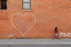 Narrowly dodging the flurry of arrows (radargeek) Tags: mural dface fortsmith ar arkansas painting art downtown heart arrows person arrow target
