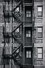 Everything Comes In Three's (dscharen) Tags: joliet fireescape rialto blackwhite three triplet illinois rialtotheater windows doors monochrome