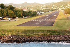 St. Lucia  airport = a bit close to the sea.... (rossendale2016) Tags: immaculate arrows arrow two second charles l f george rocks beach photogenic picturesque busy usa america wide constructed unusual safe strip tarmac tricky international helicopters heliport end terminal small popular holiday destination tourist aeroplanes aircraft adjacent water ocean over airstrip area landing close sea caribbean runway airport lucia st
