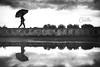 Reflected Soul... (Beppe Cavalleri - www.beppecavalleri.com) Tags: sonyzeiss3514 lines beppecavalleri sonya7riii reflex gardalake bw lake wonderful walkers blackwhite reportage urban wwwbeppecavallericom umbrella shadow street