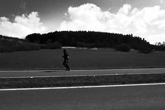 Running (stefankamert) Tags: stefankamert running clouds street lines man people noir noiretblanc grain blackandwhite blackwhite ricoh gr grd grdiv pointandshoot bw baw forest