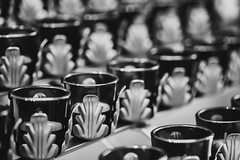 Votive Candles (Mabry Campbell) Tags: 2018 april dickinson galvestoncounty houston mabrycampbell shrineofthetruecross texas usa votive zieglercooper blackandwhite candles church commercial image photo religion sacred