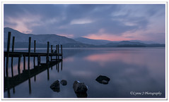 ABC_9922 - explored (Lynne J Photography) Tags: lakedistrict derwentwater bluehour longexposures jetty ashnessjetty water rocks lonetree gressmere mountains hills snowcappedpeaks sunset