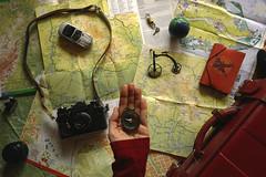 Let's travel!// Viajemos! (Mireia B. L.) Tags: travel maps viajar brújula redsuitcase vintageredsuitcase stilllife compass getlost perderse fromabove mapas maletarojavintage maletaroja