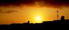 Skyline (jimiliop) Tags: sky skyline sunset orange contrast clouds antennas roofs chimneys