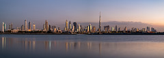 Dubai Skyline at sunset, UAE (DavidGabis) Tags: asia east city beauty panorama lights iconic sky middleeast horizontal development landscape sunset landmark cityscape weather town clear urban silhouette towers skyscrapers afternoon burjkhalifa horizon high water peninsula background uae sea panoramic coastal dubai scenic arabia bay house unitedarabemirates view night estate modern downtown design climate arabian emirates scene buildings outdoor ocean evening travel clouds black exterior blue coastline architecture beautiful futuristic skyline gulf tall sunrise coast arabic tourism arab arid