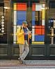 Blending into Mondrian (Antropoturista) Tags: thenetherlands thehague denhaag nino man mondrian marketing red blue yellow stret showwindow reading