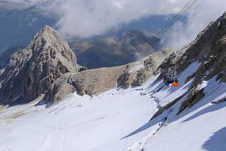 The Marmolada aerial tramway moves you from summer to winter time