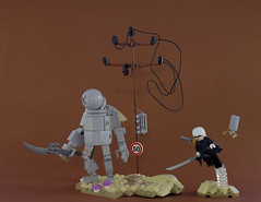 Desert encounter (Tino Poutiainen) Tags: lego legomoc legobuild minifigure robot nier automata anime desert battle fight display scale pod 2b 9s machine apocalypse android action sand wire pole