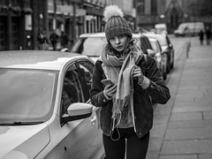 A Brief Interruption (Leanne Boulton) Tags: people portrait urban street candid portraiture streetphotography candidstreetphotography candidportrait streetportrait eyecontact candideyecontact streetlife woman female girl eyes face expression mood walking cold winter weather beanie bobble hat perspective tone texture detail depthoffield bokeh naturallight outdoor light shade city scene human life living humanity society culture canon canon5d 5dmkiii 70mm ef2470mmf28liiusm black white blackwhite bw mono blackandwhite monochrome glasgow scotland uk