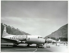 Queenstown Airport HS 748 in foreground, DC3s in background. (Archives New Zealand) Tags: archivesnewzealand archives archivesnz nationalpublicitystudios aotearoa tourism newzealand newzealandhistory nz nzhistory history