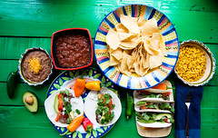 Mexican tacos for Lunch with chips (7KSDUNSAF4GRDDWD5UGAUW6IOF) Tags: authentic avocado background beef cheese chips cilantro corn food fresh green lime lunch meal meat mexican nachos onion pepper plate salsa sauce snack soft spicy taco tacos tomato tortilla traditional verde wood yellow